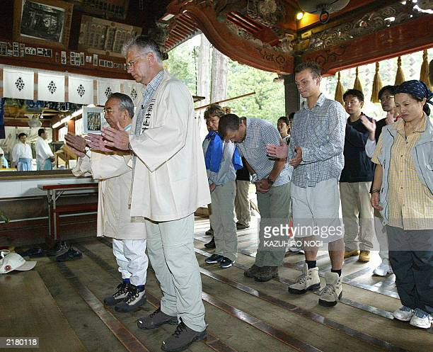 Hartwig Gauder former German Olympic champion and his supporters clap hands in prayer for a safe mountain climb to Mt Fuji at Fuji Sengen Shrine in...