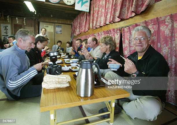Hartwig Gauder former German Olympic champion and his supporters enjoy dinner in a mountain house at Mt Fuji Yamanashi Prefecture 18 July 2003 Gauder...