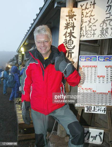 Hartwig Gauder former German Olympic champion gestues as he celebrates after reaching the summit of Mt Fuji776metre 19 July 2003 Gauder is on a...