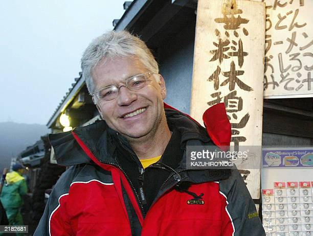 Hartwig Gauder former German Olympic champion smiles as he celebrates after reaching the summit of Mt Fuji776metre 19 July 2003 Gauder is on a twoday...