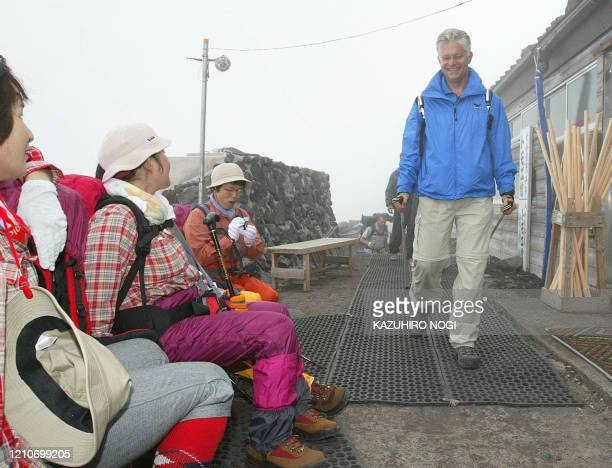 Hartwig Gauder former German Olympic champion walks past Japanese female visitors as he climbs Mt Fuji with a transplanted heart to appeal to the...