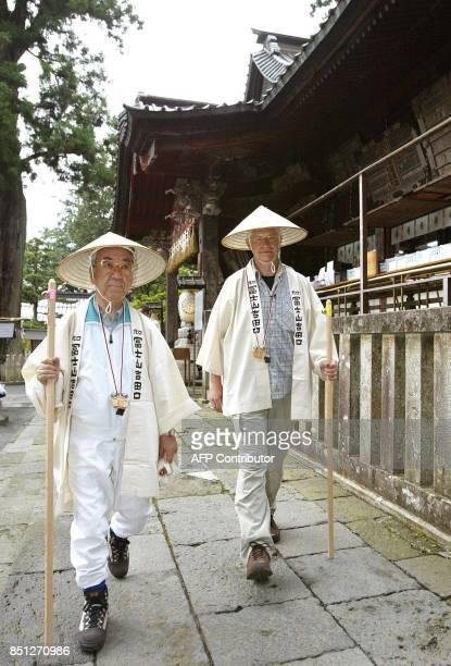 Hartwing Gauder former German Olympic champion and Fujiyoshida city mayor Toshio Kayanuma depart Fuji Sengen Shrine in Fujiyoshida Yamanashi...