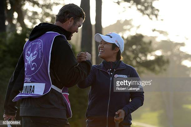 Haru Nomura of Japan celebrates with her caddie Jason McDede after winning the Swinging Skirts LPGA Classic presented by CTBC at the Lake Merced Golf...