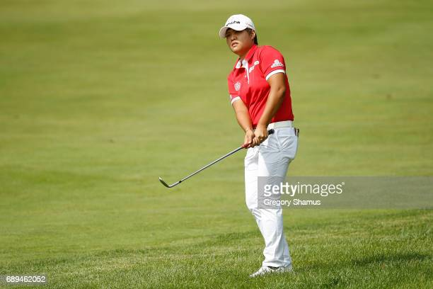 Haru Nomura of Japan chips to the sixth green during the final round of the LPGA Volvik Championship on May 28 2017 at Travis Pointe Country Club Ann...