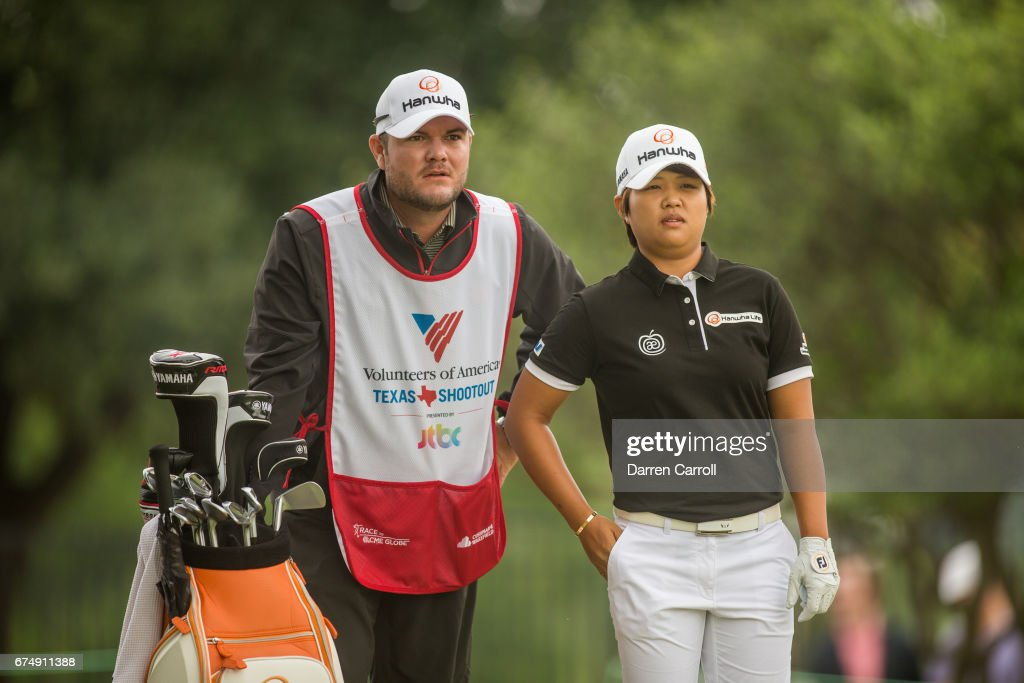 Haru Nomura of Japan discusses her tee shot strategy at the second hole with her caddie during the third round of the Volunteers of America North Texas Shootout at Las Colinas Country Club on April 29, 2017 in Irving, Texas.