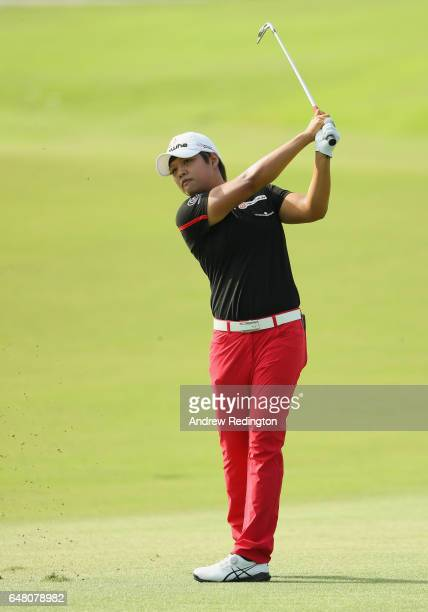 Haru Nomura of Japan hits her second shot on the 10th hole during the final round of the HSBC Women's Champions on the Tanjong Course at Sentosa Golf...