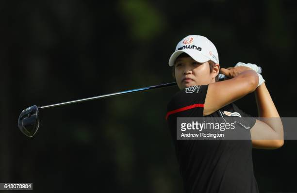 Haru Nomura of Japan hits her tee shot on the 11th hole during the final round of the HSBC Women's Champions on the Tanjong Course at Sentosa Golf...
