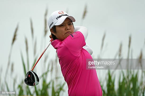 Haru Nomura of Japan hits her tee shot on the third hole during the first round of the ShopRite LPGA Classic presented by Acer on the Bay Course at...