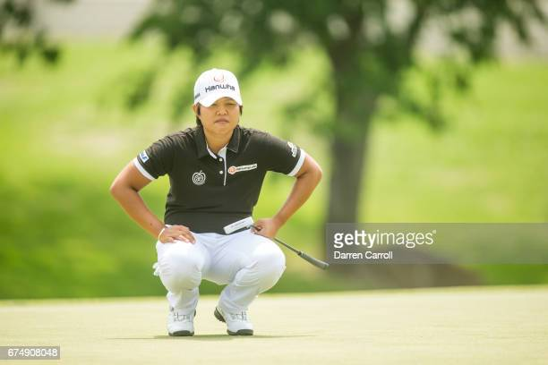 Haru Nomura of Japan plays her lines up a putt at the thirteenth hole during the third round of the Volunteers of America North Texas Shootout at Las...