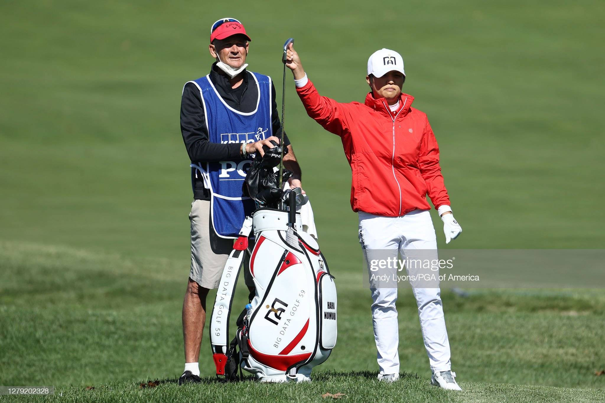 https://media.gettyimages.com/photos/haru-nomura-of-japan-talks-with-her-caddie-on-the-12th-hole-during-picture-id1279202328?s=2048x2048