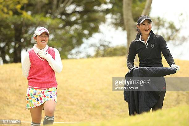 Haruhi Nakao of Japan and Jennifer Hirano of the USA smile during the first round of the AXA Ladies Golf Tournament at the UMK Country Club on March...
