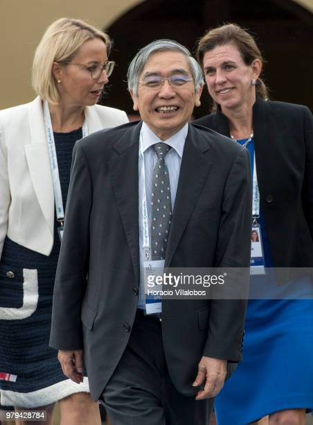Haruhiko Kuroda, Governor of Bank of Japan, leaves at the end of the afternoon discussion session during the last day of ECB Forum on Central...