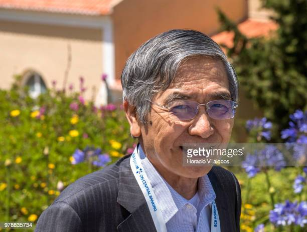 Haruhiko Kuroda, Governor of Bank of Japan, smiles while leaving at the end of the first discussion session of the ECB Forum on Central Banking, on...