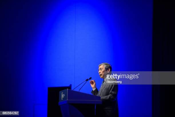 Haruhiko Kuroda governor of Bank of Japan speaks during the Institute of International Finance Spring Membership Meeting in Tokyo Japan on Tuesday...