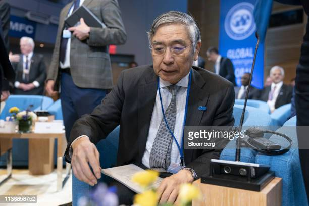 Haruhiko Kuroda, governor of the Bank of Japan , arrives for an International Monetary Fund governors group photo at the spring meetings of the...