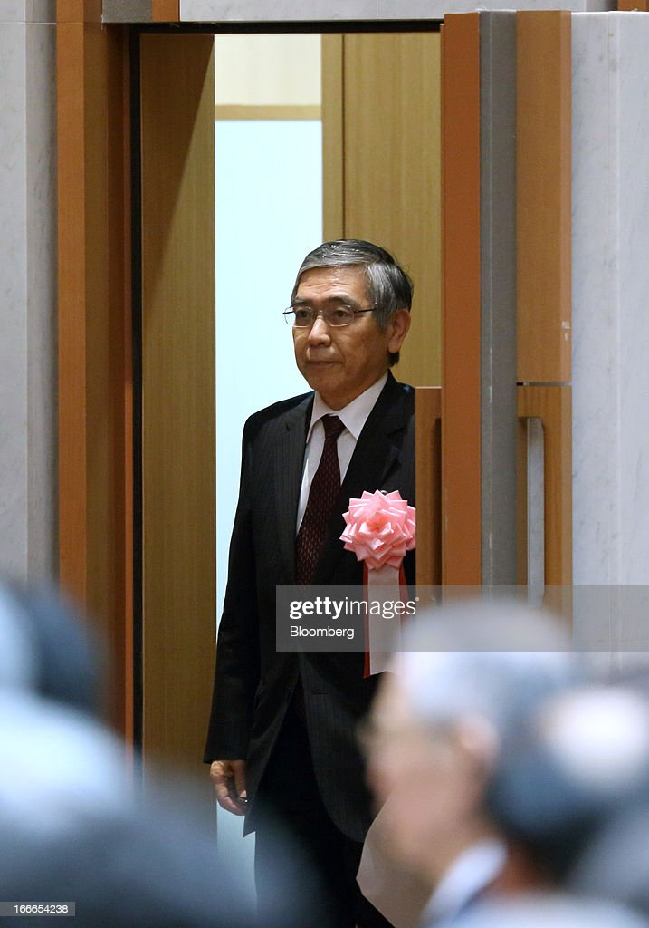 Haruhiko Kuroda, governor of the Bank of Japan (BOJ), arrives for the annual meeting of the Trust Companies Association of Japan in Tokyo, Japan, on Monday, April 15, 2013. Kuroda reiterated today that he has a two-year time horizon in mind for achieving his inflation goal. He will also speak today at the annual meeting. Photographer: Tomohiro Ohsumi/Bloomberg via Getty Images