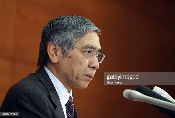 Haruhiko Kuroda governor of the Bank of Japan attends a news conference at the central bank's headquarters in Tokyo Japan on Tuesday Oct 7 2014 The...
