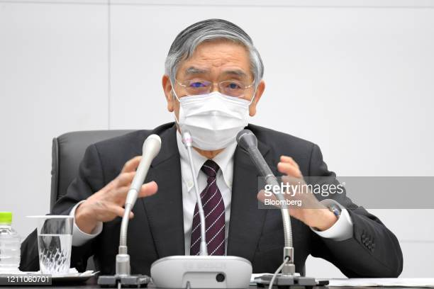 Haruhiko Kuroda, governor of the Bank of Japan , gestures as he speaks during the central bank's headquarters in Tokyo, Japan, on Monday, April 27,...