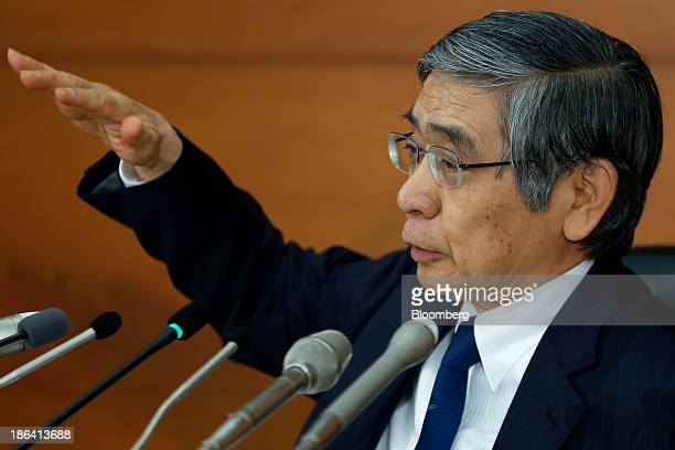 Haruhiko Kuroda governor of the Bank of Japan gestures as he speaks during a news conference at the central bank's headquarters in Tokyo Japan on...
