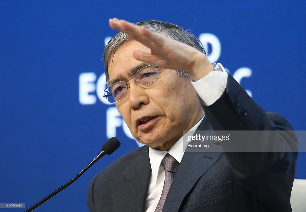 Haruhiko Kuroda, governor of the Bank of Japan (BOJ), gestures as he speaks during a session on the final day of the World Economic Forum (WEF) in Davos, Switzerland, on Saturday, Jan. 24, 2015. World leaders, influential executives, bankers and policy makers attend the 45th annual meeting of the World Economic Forum in Davos from Jan. 21-24. Photographer: Simon Dawson/Bloomberg via Getty Images