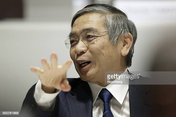 Haruhiko Kuroda governor of the Bank of Japan gestures as he speaks during a luncheon at the Paris Europlace International Financial Forum in Tokyo...