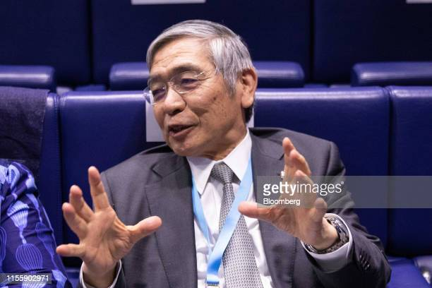 Haruhiko Kuroda governor of the Bank of Japan gestures while sat in the audience during the 75th anniversary of the Bretton Woods system of monetary...