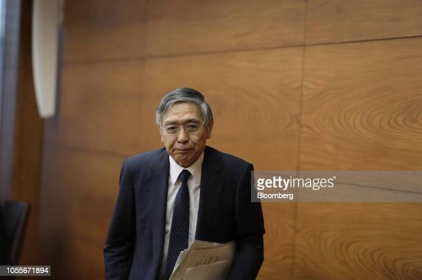 Haruhiko Kuroda, governor of the Bank of Japan , leaves a news conference at the central bank's headquarters in Tokyo, Japan, on Wednesday, Oct. 31,...