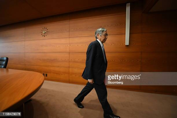 Haruhiko Kuroda, governor of the Bank of Japan , leaves a news conference at the central bank's headquarters in Tokyo, Japan, on Tuesday, July 30,...