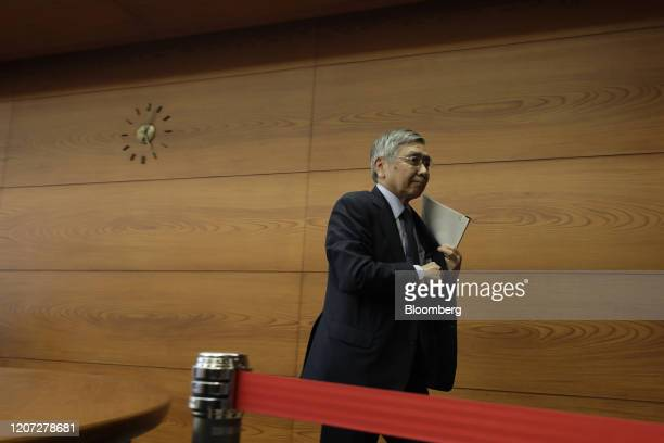 Haruhiko Kuroda, governor of the Bank of Japan , leaves a news conference at the central bank's headquarters in Tokyo, Japan, on Monday, March 16,...