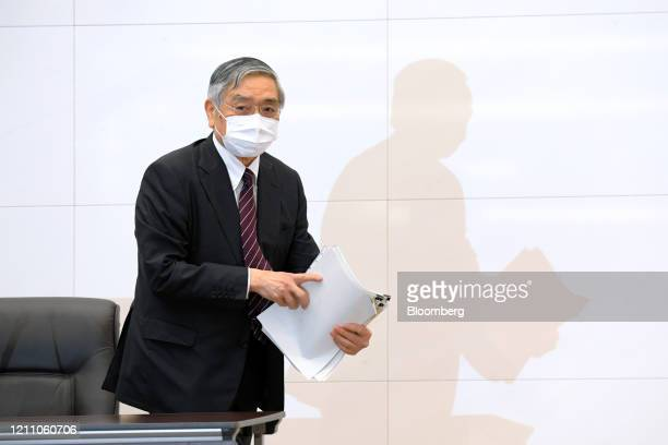 Haruhiko Kuroda governor of the Bank of Japan leaves a news conference at the central bank's headquarters in Tokyo Japan on Monday April 27 2020 The...