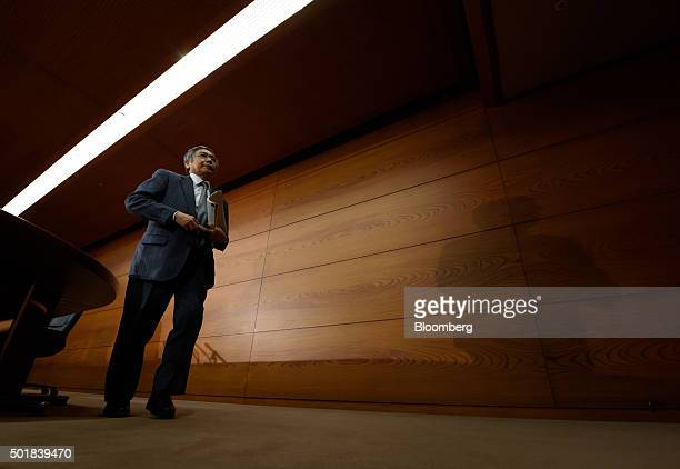 Haruhiko Kuroda governor of the Bank of Japan leaves a news conference at the central bank's headquarters in Tokyo Japan on Friday Dec 18 2015 The...