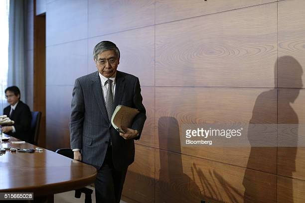 Haruhiko Kuroda governor of the Bank of Japan leaves a news conference at the central bank's headquarters in Tokyo Japan on Tuesday March 15 2016 The...