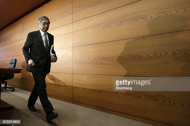 Haruhiko Kuroda governor of the Bank of Japan leaves a news conference at the central bank's headquarters in Tokyo Japan on Thursday April 28 2016...