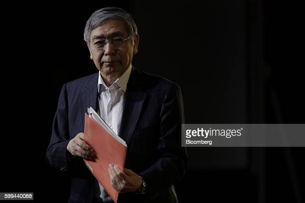 Haruhiko Kuroda governor of the Bank of Japan leaves the stage after delivering his speech at a meeting hosted by Kyodo News in Tokyo Japan on Monday...