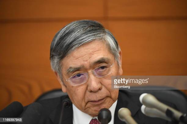 Haruhiko Kuroda, governor of the Bank of Japan , listens during a news conference at the central bank's headquarters in Tokyo, Japan, on Thursday,...