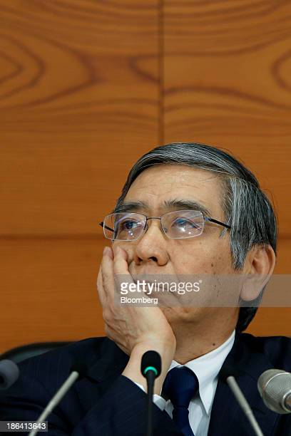 Haruhiko Kuroda governor of the Bank of Japan listens during a news conference at the central bank's headquarters in Tokyo Japan on Thursday Oct 31...