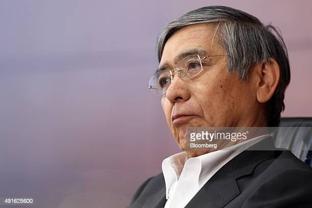 Haruhiko Kuroda governor of the Bank of Japan listens during a news conference at the central bank's headquarters in Tokyo Japan on Wednesday Oct 7...