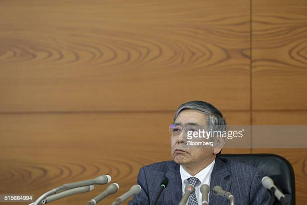Haruhiko Kuroda governor of the Bank of Japan listens during a news conference at the central bank's headquarters in Tokyo Japan on Tuesday March 15...