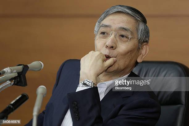 Haruhiko Kuroda governor of the Bank of Japan listens during a news conference at the central bank's headquarters in Tokyo Japan on Thursday June 16...