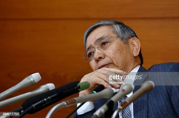 Haruhiko Kuroda governor of the Bank of Japan listens to a question during a news conference at the central bank's headquarters in Tokyo Japan on...