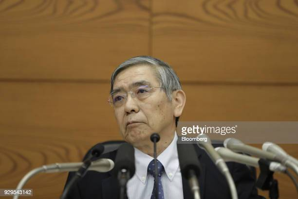 Haruhiko Kuroda, governor of the Bank of Japan , listens to a question from a member of the media during a news conference at the central bank's...