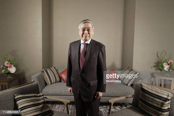 Haruhiko Kuroda, governor of the Bank of Japan , poses for a photograph following a Bloomberg Television interview in Fukuoka, Japan, on Monday, June...