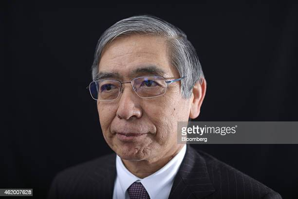 Haruhiko Kuroda, governor of the Bank of Japan , poses for a photograph following a Bloomberg Television interview on day three of the World Economic...