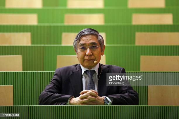Haruhiko Kuroda governor of the Bank of Japan poses for a photograph before delivering a speech at the University of Zurich in Zurich Switzerland on...