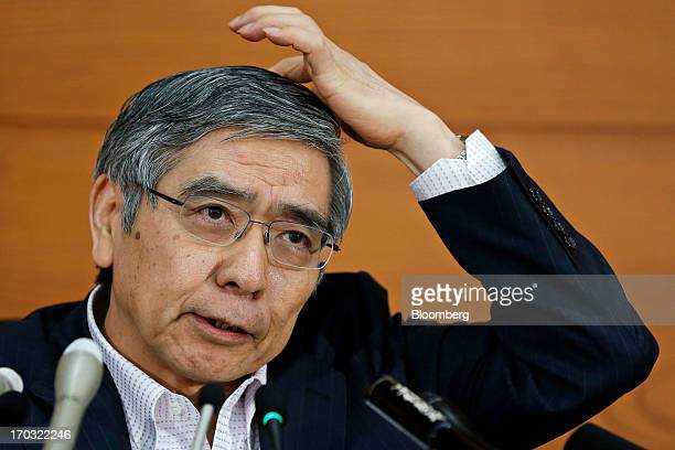 Haruhiko Kuroda governor of the Bank of Japan reacts as he speaks during a news conference at the central bank's headquarters in Tokyo Japan on...