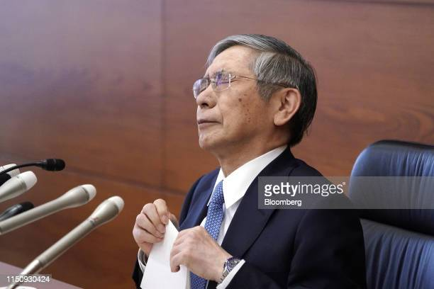 Haruhiko Kuroda, governor of the Bank of Japan , reacts during a news conference at the central bank's headquarters in Tokyo, Japan, on Thursday,...
