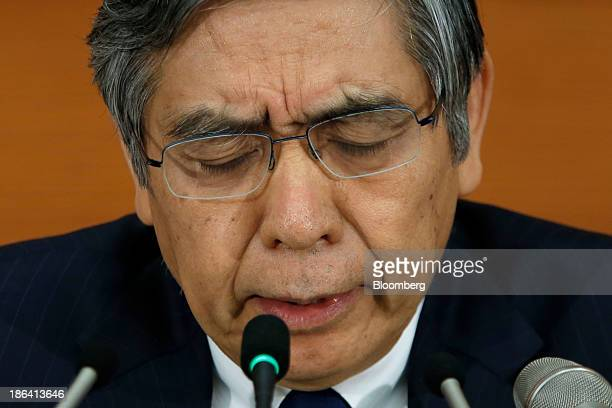 Haruhiko Kuroda governor of the Bank of Japan reacts during a news conference at the central bank's headquarters in Tokyo Japan on Thursday Oct 31...