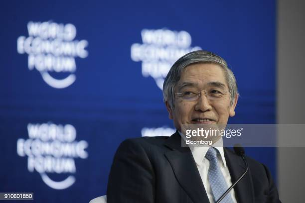 Haruhiko Kuroda governor of the Bank of Japan reacts during a panel session on the closing day of the World Economic Forum in Davos Switzerland on...