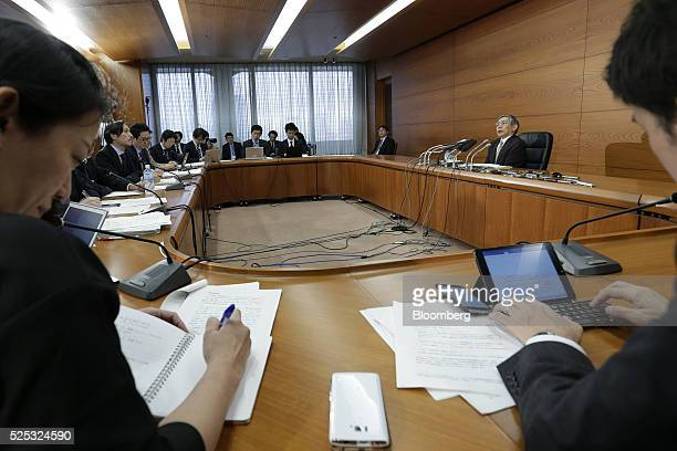 Haruhiko Kuroda governor of the Bank of Japan right speaks during a news conference at the central bank's headquarters in Tokyo Japan on Thursday...