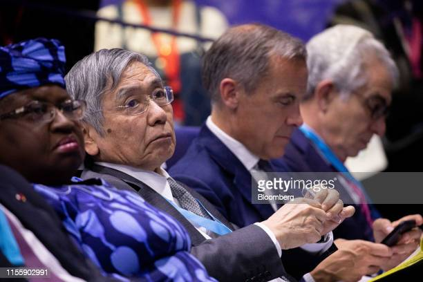 Haruhiko Kuroda governor of the Bank of Japan sits in the audience during the 75th anniversary of the Bretton Woods system of monetary management in...